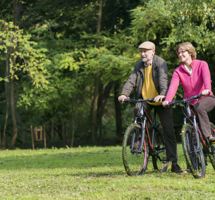 Senior couple riding bicycles in the nature