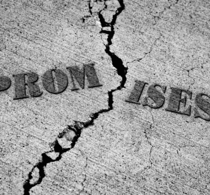Broken promises with crack in concrete with words
